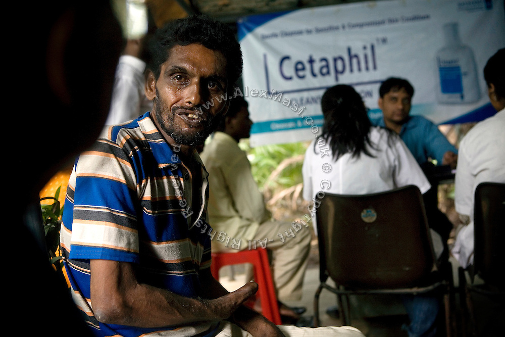 A leprosy patient is talking to a doctor at the clinic supported by Sonrisas de Bombay, a fast-growing Spanish NGO in Mumbai, India.