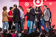 Vice President Joseph R. Biden, center, smiles on stage at the Unite America in Service event, part of the National Day of Service, at the DC Armory on Saturday, January 19, 2013 in Washington, DC.