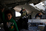 """Palestinian woman Wafa al-Wajar and  her  two youngest children Dyaha and Zekryat during an emotional  journey back to  the rubble of their home March 28,2009..The al -Wajar family became homeless when Israeli bulldozers destroyed their home in the northern Gaza neighborhood of Seyfea on January 4,2009 during ,""""Operation Cast Lead""""..Both the mother and the father were shot and their son Ibraheem was killed when the family tried to escape .(Photo by Heidi Levine/Sipa Press)."""