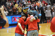 "Col. Chris Davis greets his family Lori and sons Braxton (wearing glasses) and McKinley at the Ole Miss vs. Alabama game at the C.M. ""Tad"" Smith Coliseum in Oxford, Miss. on Wednesday, February 26, 2014. (AP Photo/Oxford Eagle, Bruce Newman)"