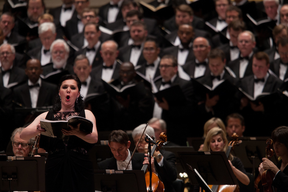 Soprano Evelina Dobracheva with Music Director and Conductor Robert Spano and the Atlanta Symphony Orchestra and Chorus performing Britten's War of Requiem at Carnegie Hall in New York, NY on April 30, 2014.