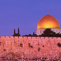 Jerusalem's Dome of the Rock and city walls at Sunrise, viewed from the East.
