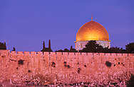 Jerusalem's Dome of the Rock and city walls at Sunrise, viewed from the East. WATERMARKS WILL NOT APPEAR ON PRINTS OR LICENSED IMAGES.