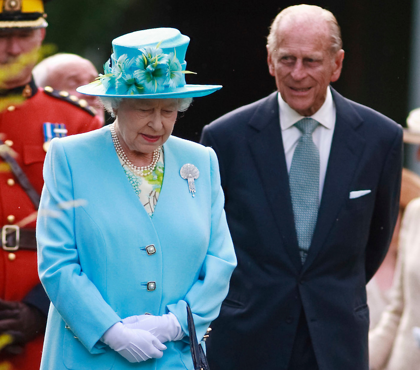 Queen Elizabeth and Prince Philip, The Duke of Edinburgh, tour a garden reception at Rideau Hall, the Queen's official residence in Ottawa, Canada, June 30, 2010. The Queen is on a 9 day visit to Canada. <br /> AFP/GEOFF ROBINS/STR