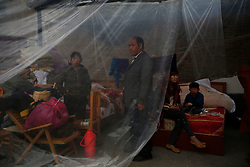 A Chinese family affected by the earthquake is seen in a temporary shelter in Taiping town of Lushan County, Sichuan Province, China, 23 April 2013. The Lushan Earthquake in Sichuan Province on 20 April 2013 resulted in 186 people dead, 21 missing, 11248 injured. About 1.72 million people were affected by the quake, while an initial estimate by the International Red Cross on Saturday put the number needing emergency shelter, water and food at 120,000. The China Earthquake Administration (CEA) recorded a magnitude 7.0 earthquake, while the US Geological Survey said it had measured 6.9.