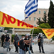 Protestors holding the greek flag in front of the parliament in Syntagma  (Constitution) square in Athens June 29, 2011