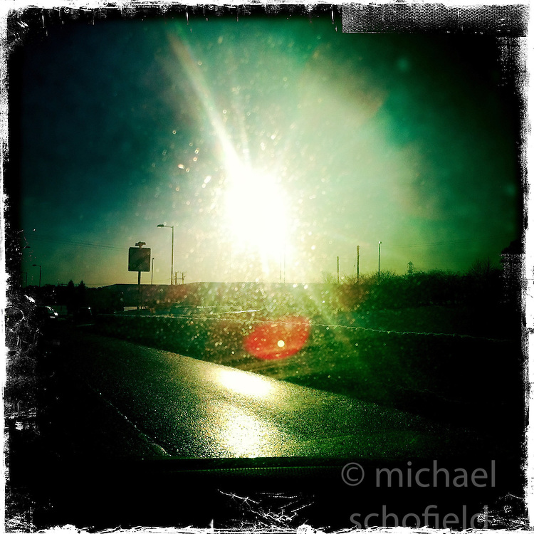 Sun on road..Hipstamatic images taken on an Apple iPhone..©Michael Schofield.