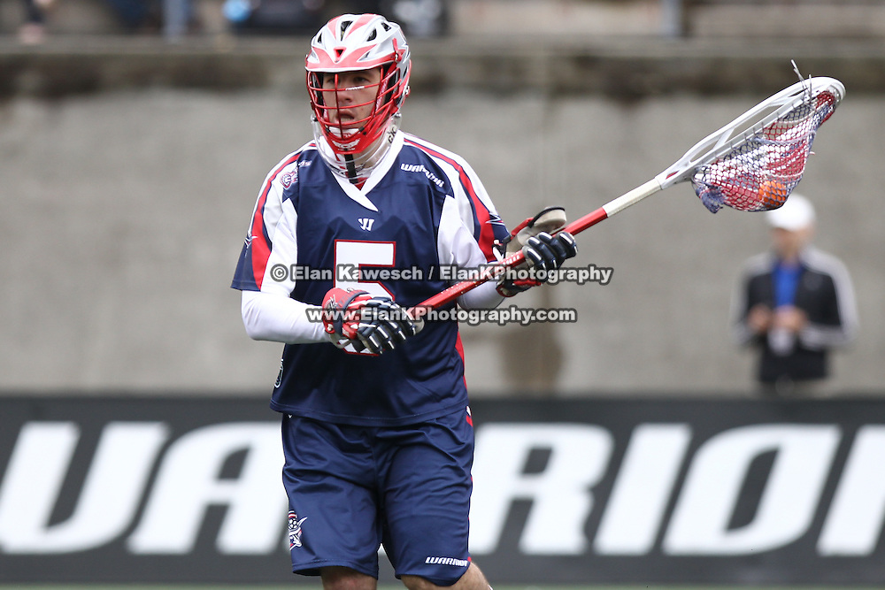 Jordan Burke #5 of the Boston Cannons controls the ball during the game at Harvard Stadium on April 27, 2014 in Boston, Massachusetts. (Photo by Elan Kawesch)