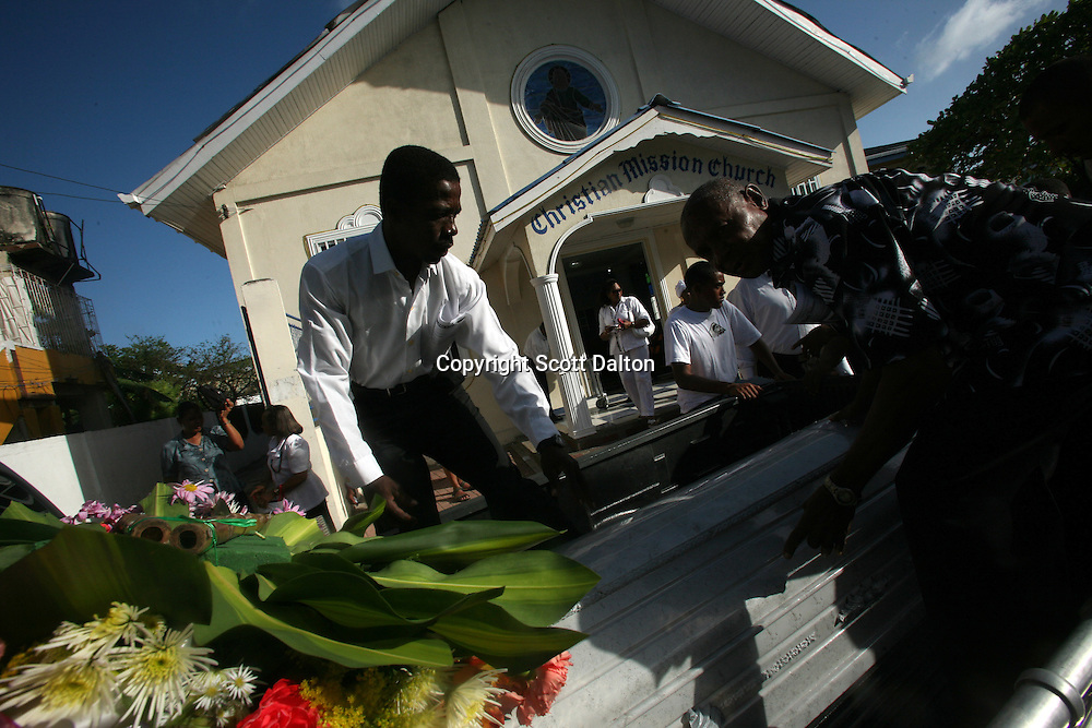 A coffin is loaded on a car after a traditional funeral of a local Raizal man in San Andres, a small island in the Caribbean, on Tuesday, January 22, 2008. San Andres belongs to Colombia, and was turned into a free trade zone in the 1950?s, since then colonization of the islands, inspired by trade and tourism, has left the local population a minority and in turn many customs and traditions are slowly being lost. (Photo/Scott Dalton).