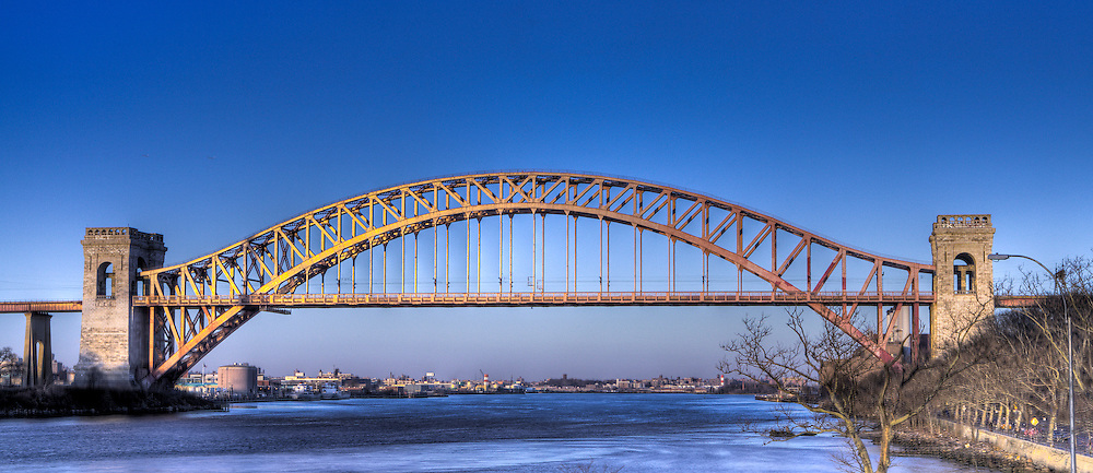 A frontal view of the Hellsgate Bridge in Astoria Park in Queens New York.  This image was made using the High Dynamic Range technique and processed in Photoshop.