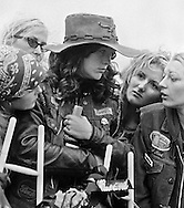 Kathy Holston, wife of Robert Holston, surrounded by friends at the graveside.<br /> Funeral service for Robert (Moose) Holston, 27, Kentucky chapter president of the Iron Horseman motorcycle club.  He was buried by his club members at a &quot;cycle funeral&quot; at St. Stephens Cemetery in Ft. Thomas, KY.  Holston was stabbed to death during a fight at the headquarters of the Seventh Sons motorcycle club in Newport, KY.  About 500 cyclists from Kentucky, Ohio and Indiana attended the funeral.