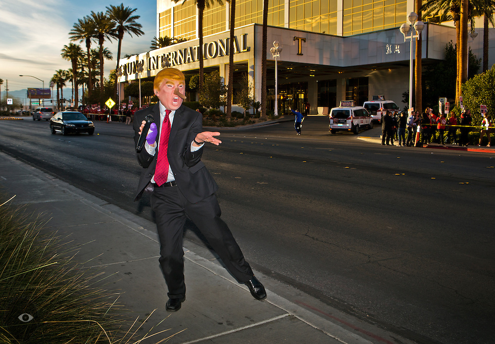 Dr. Gil Mobley wears a Donald Trump map and performs his song before Culinary Workers Union 226 members holding a protest at the Trump International Hotel & Tower to highlight its organizing campaign on caucus day, Tuesday, February 23, 2016.   L.E. Baskow