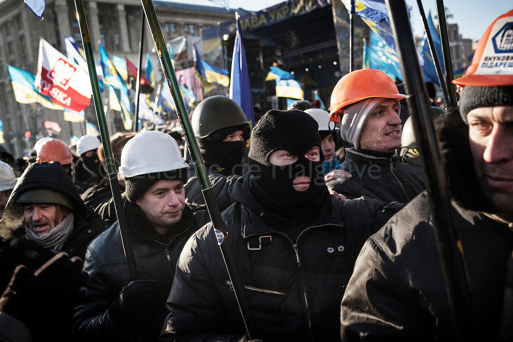 Far-right party Svoboda members march amid the crowd after their leader Oleg Tyagnibok delivered a speech to a large audience of anti-government protesters attending  the Sunday demonstration on Maidan Square  in Kiev, 02 February 2014.