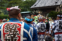 Wearing a Harumaki at Kamakura Matsuri - Japanese festivals are traditional festive occasions with their roots in Chinese festivals having undergone dramatic changes as they mixed with local customs.  Such events are usually sponsored by the local shrine though they can be occasionally be secular.
