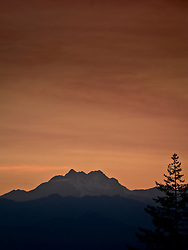 evening lighted cloudy sky over The Brothers (mountain) in the Olympic Mountains, Washington, USA