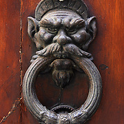 SHOT 3/2/2006 - A door knocker on a doorway in Siena, Italy. Siena is a city in Tuscany, Italy. It is the capital of the province of Siena. The historic center of Siena has been declared by UNESCO a World Heritage Site..(MARC PISCOTTY/ © 2006)