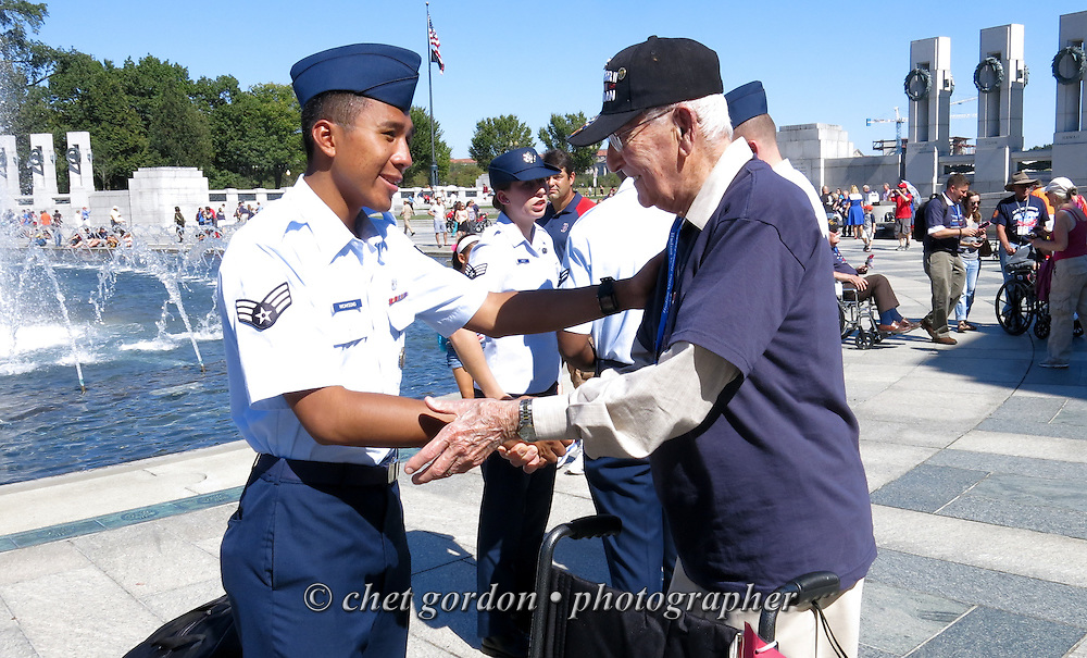 WWII Veterans and their escorts at the WWII Memorial in Washington, DC during their Hudson Valley Honor Flight on Saturday, September 27, 2014. Nearly one hundred WWII Veterans from the Hudson Valley region of New York toured the WWII Memorial in Washington, DC and Arlington National Cemetery in Arlington, VA.  © www.chetgordon.com