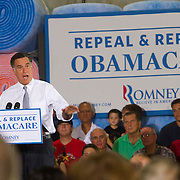 Republican Presidential Candidate Mitt Romney asks his supporters to &quot;Repeal &amp; Replace ObamaCare.&quot; <br /> Photo by James Branaman