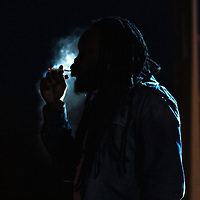 07/30/11 Wilmington DE: Reggae artist Bushman lights up a spliff on stage while performing live at The Bob Marley 17th Annual Peoples Festival Saturday, July 30, 2011, at Tubman-Garrett Riverfront Park in Wilmington Delaware.<br /> <br /> Monsterphoto/SAQUAN STIMPSON