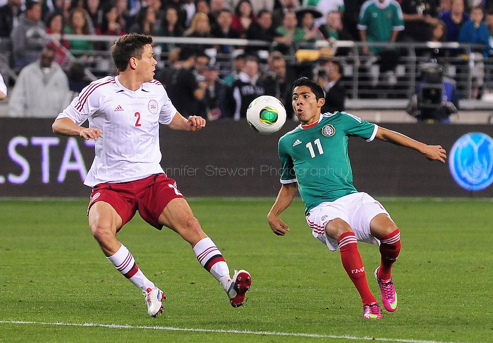 Jan. 30, 2013; Glendale, AZ, USA; Mexico midfielder Javier Aquino (11) watches the ball while being defended by Denmark midfielder Mads Albaek (2) during the international friendly match against Denmark in the first half at University of Phoenix Stadium. Mexico and Denmark ended in a 1-1 draw. Mandatory Credit: Jennifer Stewart-USA TODAY Sports..Jan. 30, 2013; Glendale, AZ, USA; Denmark XXX the ball during the international friendly match against Mexico in the first half at University of Phoenix Stadium. Mexico and Denmark ended in a 1-1 draw. Mandatory Credit: Jennifer Stewart-USA TODAY Sports
