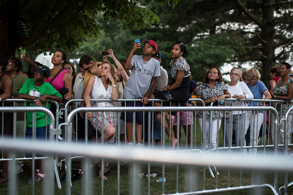 ARLINGTON, VA - AUGUST 2: Members of the crowd listen behind barricades as President Barack Obama holds a campaign rally at Loudoun County High School on August 2, 2012 in Leesburg, VA. Obama campaigned earlier in the day in Florida. (Photo by Brendan Hoffman/Getty Images) *** Local Caption ***