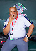 SAN JUAN, PUERTO RICO FEBRUARY 3: The manager for Cuba Team, Alfonso Urquiola, smokes a cigar in the dugout before the game against the Dominican Republic  on February 3, 2015 in San Juan, Puerto Rico at Hiram Bithorn Stadium (Photo by Jean Fruth)