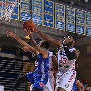 Westchester Knicks Guard JORDON CRAWFORD (1) drives to the basket as Delaware 87ers Forward DAVID LAURY (13) defends in the first half of a NBA D-league regular season basketball game between the Delaware 87ers and the Westchester Knicks  Saturday Dec, 26, 2015 at The Bob Carpenter Sports Convocation Center in Newark, DEL