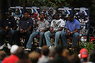 Former Ole Miss football players (from l.) Chris Spencer of the Seattle Seahawks, Charlie Anderson of the Miami Dolphins, Dexter McCluster, Jason Cook, and Jesse Mitchell speak during Grove Bowl pre-game activities in the Grove at the University of Mississippi in Oxford, Miss. on Saturday, April 17, 2010.