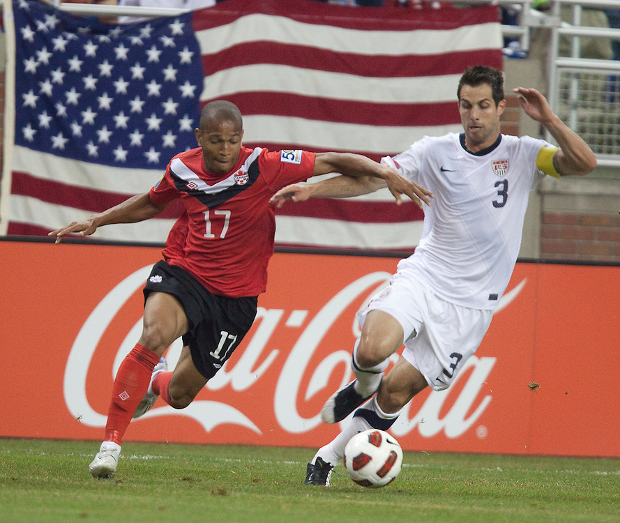 GR8007 -20110607- Detroit, Michigan,USA<br /> Carlos Bocanegra of the United States and Canada's Simeon Jackson fight for the ball during their CONCACAF match at Ford Field in Detroit Michigan, June 7, 2011.<br /> AFP PHOTO/Geoff Robins