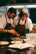 Photos in the kitchen at Willows Inn restaurant on Lummi Island, WA