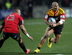 Chiefs' Sona Taumalolo avoids a challenge from Crusaders' Robbie Fruean in the semi-final Super Rugby match, Waikato Stadium, Hamilton, New Zealand, Friday, July 27, 2012.  Credit:SNPA / David Rowland