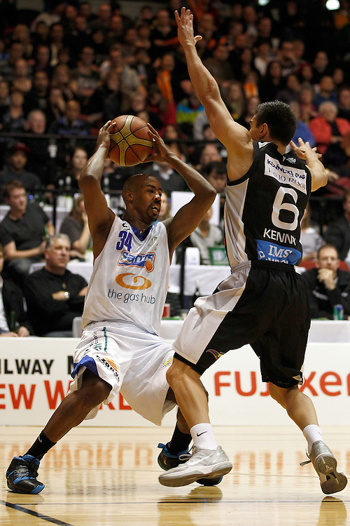 Wellington Saints' guard Jason Crowe, left, stops short as he runs into Hawkes Bay Hawks' guard Jerrod Kenny in the second semi-final of the National Basketball League, TSB Bank Arena, Wellington, New Zealand, Saturday, May 26, 2012. Credit: SNPA/Dean Pemberton.