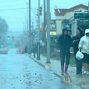 10/29/12 - Newark, DE - Hurricane Sandy -  A group of people walk Main Street in heavy rain Monday, Oct. 29, 2012, in Newark DE. ..SAQUAN STIMPSON/Special to The News Journal