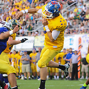 Gold Ian Gory (9) of Dover High School attempts a pass in the pocket in the first-quarter of the 58th Annual DFRC Blue-Gold All-Star Football game Saturday, June. 22, 2013, at Delaware Stadium in Newark DE.