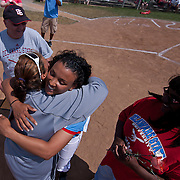 04/21/12 Dover Del. Delaware State Jordan Reid #12 hug her coach during a tribute to the Delaware State senior class prior to the start of a NCAA Softball game against Norfolk State Saturday, April. 21, 2012 at The Hornets Nest in Dover Del.<br /> <br /> Delaware State defeated Norfolk State 10-0 Saturday afternoon.<br /> <br /> Special to The News Journal/SAQUAN STIMPSON