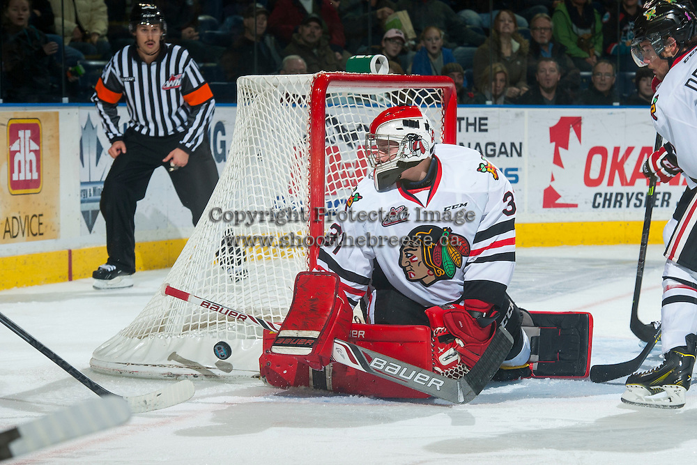 KELOWNA, CANADA - NOVEMBER 22: Adin Hill #31 of Portland Winterhawks deflects a shot against the Kelowna Rockets on November 22, 2014 at Prospera Place in Kelowna, British Columbia, Canada.  (Photo by Marissa Baecker/Shoot the Breeze)  *** Local Caption *** Adin Hill;