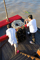 Mekong River Boat Le Bassac Crew Pulling up Anchor - The Mekong River is the worlds 10th longest river running for over 4000 kilometers from the Tibetan Plateau through China's Yunnan province, Burma, Thailand, Laos, Cambodia and Vietnam. The difficulty of navigating the river has meant that it has divided rather than united the people who live near it.