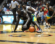 "Coastal Carolina's El Hadji Ndieguene (11) gets control of the ball from Mississippi's Derrick Millinghaus (3) at the C.M. ""Tad"" Smith Coliseum in Oxford, Miss. on Tuesday, November 13, 2012. (AP Photo/Oxford Eagle, Bruce Newman)"