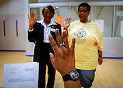 SAVANNAH, GA - FEBRUARY 5: Poll manager Julia Waldon holds her right hand up and swears in poll clerks Dorothy Valcourt, (L) and Diana Fryer (R) before opening a poll for Georgia's primary Super Tuesday's presidential election January 5, 2008 in Savannah, Georgia. An enormous cache of delegates is at stake. The two dozen state contests are delivering 1,023 Republican and 1,681 Democratic delegates. (Photo by Stephen Morton/Getty Images)