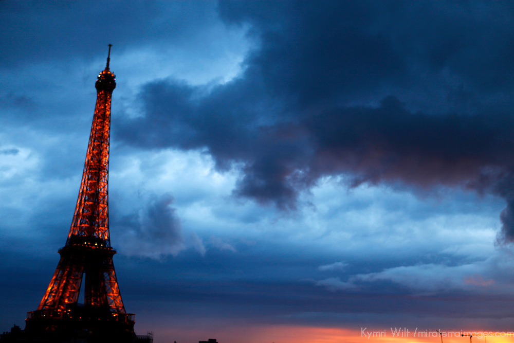 Europe, France, Paris. Eiffel Tower against a stormy sky.