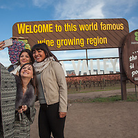 "College student friends:  Enka, Lores and Lizbeth snap a ""selfie"" near Calistoga while in front of the single most photographed sign in the Northern California,  enka@gmail.com"