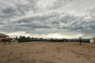 Cutting horses, cowgirl, herd holders, turn back men, Whitehall, Montana, clouds, storm