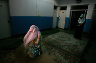 A young Muslim girl prays during Ramadan outside her dormitory at the Ningxia Institute for the Study of Islam and the Quran, in Yinchuan, in China's Ningxia province Thursday Oct. 19, 2006. Women's well-established status in religious life is evident across Ningxia, a desert region whose oases along the Yellow River were settled by Muslim traders from the Middle East. Religious schools for girls are common. Ningxia's top Islamic institute can't keep up with the demand from women applicants. China's women imams serve as an inspiration to Muslim feminists and points to a more inclusive Islam at a time when much of the Islamic world is being driven by more austerely fundamentalist versions that largely relegate women to the home.