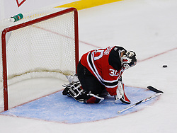 Nov 1, 2008; Newark, NJ, USA; New Jersey Devils goalie Martin Brodeur (30) grabs his left arm after making a save during the second period at the Prudential Center. New Jersey Devils goalie Martin Brodeur (30) would leave the game and be replaced by New Jersey Devils goalie Kevin Weekes (1).
