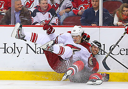 Mar 27, 2014; Newark, NJ, USA; Phoenix Coyotes center Antoine Vermette (50) and New Jersey Devils center Jacob Josefson (16) collide during the first period at Prudential Center.