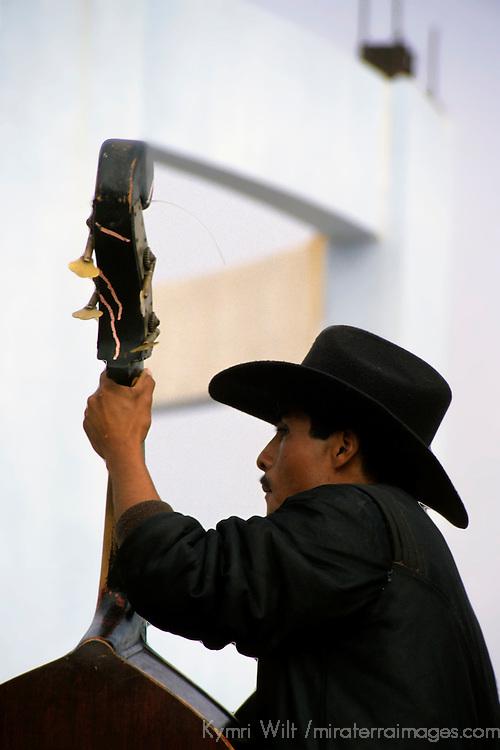 North America, Mexico, Baja California, Ensenada. One of the local musicians silhouetted at La Bufadora.