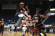 "Ole Miss' Amber Singletary (20) vs. UMass' Millie Niggeling (44) and Umass' Dee Montgomery (25) at the C.M. ""Tad"" Smith Coliseum in Oxford, Miss. on Saturday, December 8, 2012."
