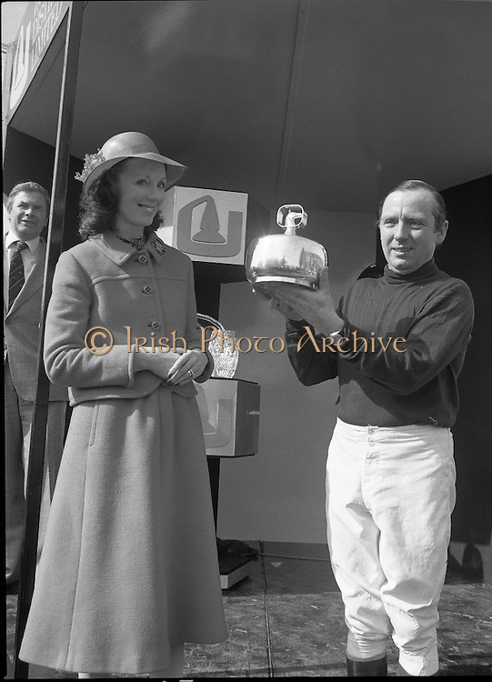 """Irish Distillers Grand National at Fairyhouse.  (M66)..1979..16.04.1979..04.16.1979..16th April 1979..The Irish Distillers Grand National was run today at Fairyhouse Racecourse, Co Meath.The race over 3.5miles is valued at £20,000. the winning trainer will also receive the Tom Dreaper,Perpetual Trophy which will be presented by Mrs Betty Dreaper..Picture of winning owner and rider of """"Tied Cottage"""", Mr Anthony Robinson accepting his trophy from Mrs Michael O'Kennedy."""