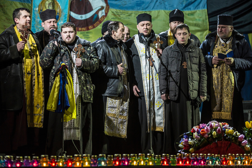 KIEV, UKRAINE - FEBRUARY 22: Orthodox priests pray on stage before a speech by former Prime Minister Yulia Tymoshenko on February 22, 2014 in Kiev, Ukraine. Tymoshenko, the leader of the 2004 Orange Revolution against current embattled President Viktor Yanukovych traveled to Kiev to address the crowd immediately after being released from prison on what many claim were politically motivated charges. (Photo by Brendan Hoffman/Getty Images) *** Local Caption ***