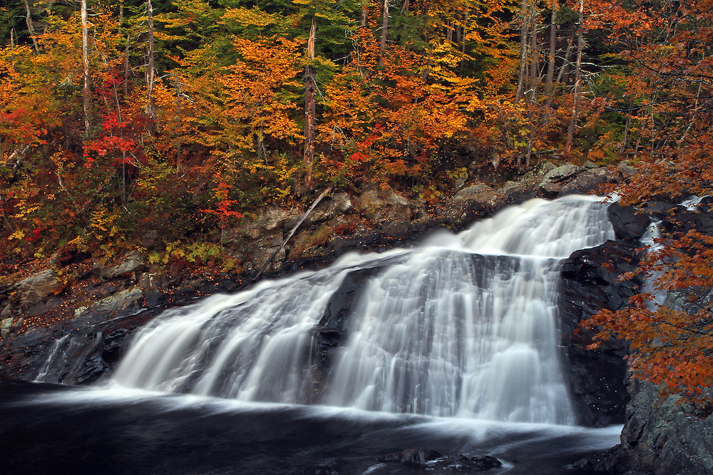 Landscape photography images of this glorious waterfall autumn scenery at Profile Falls in New Hampshire are available as museum quality photography prints, canvas prints, acrylic prints or metal prints. Prints may be framed and matted to the individual liking and decorating needs:<br /> <br /> http://juergen-roth.artistwebsites.com/featured/tumbling-new-hampshire-profile-waterfall-juergen-roth.html<br /> <br /> New Hampshire waterfall photography of pretty Profile Falls off NH Route 3A near Bristol and the White Mountains region photographed during peak colors of the New England fall foliage in October. This view features the Profile Waterfalls from the pool below falls.<br /> <br /> Good light and happy photo making!<br /> <br /> Juergen <br /> Prints: www.RothGalleries.com<br /> Licensing: www.ExploringTheLight.com<br /> Photo Blog: http://whereintheworldisjuergen.blogspot.com<br /> @NatureFineArt
